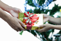Hands giving and receiving a present Royalty Free Stock Images