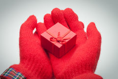 Hands giving red box with present Stock Photos