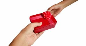 Hands giving a red gift box isolated on white background stock images