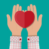 Hands giving red heart. Hands holds and giving red heart. Concept of charity, love, sincerity, relationship. Vector illustration in flat style Stock Photo