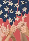 Hands giving thumbs up against blue hand drawn star pattern and red background Stock Photos