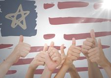 Hands giving thumbs up against hand drawn american flag and white wall with flare Royalty Free Stock Photography