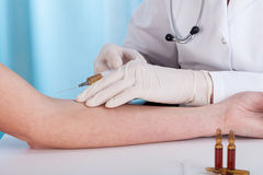 Hands giving vaccination injection Royalty Free Stock Photos