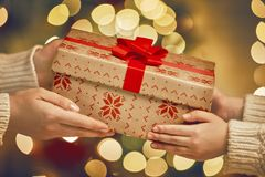 Hands giving x-mas gift Royalty Free Stock Photography