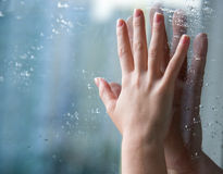 Hands through glass Royalty Free Stock Image