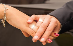Hands with glittering wedding rings Royalty Free Stock Images