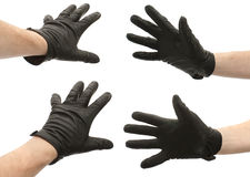 Hands in gloves stock images