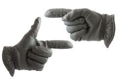 Hands in gloves Royalty Free Stock Photography