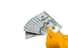 Hands in gloves with banknotes stock image