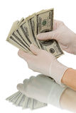 Hands in gloves believe Dollars Stock Photo