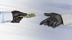 Hands in gloves exchange one american dollar Stock Photos