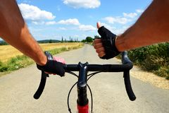 Cyclist rides on a road bike. Stock Photo