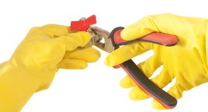 Hands in gloves with pliers, isolated on white Royalty Free Stock Photo