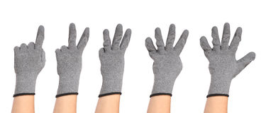 Hands in gloves show figures Stock Photography