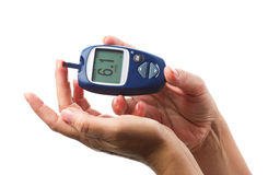 Hands with glucometer Royalty Free Stock Photos
