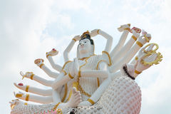 18 hands God statue Guanyin on background of blue sky in templ Royalty Free Stock Photo