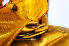Hands of Gold Buddha concentration Stock Photo