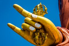 Hands on gold Buddha statue Stock Photography