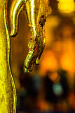 Hands of gold Buddha statue stock photos
