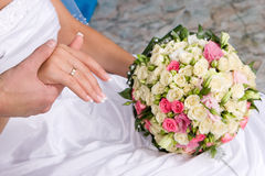 Hands with gold rings and flower bouquet#1 Stock Photography