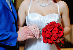 Hands with gold wedding rings bride and groom on the background Royalty Free Stock Images