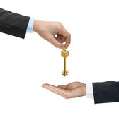 Hands and golden key Royalty Free Stock Photography