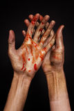 Hands in golden and red paint Royalty Free Stock Photography