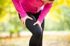 Hands grabbing a hip, sport injury Stock Images