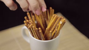 Hands grabbing salty sticks stock video footage