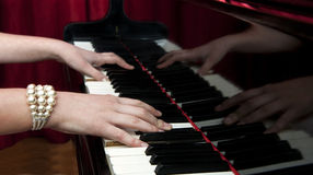 Hands on Grand Piano Royalty Free Stock Images