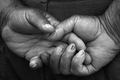 Hands of a grandfather. Black and white hands of an elderly man Stock Image
