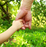 Hands grandfather and grandson Stock Images
