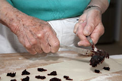 Hands of grandmother at backing Stock Photo