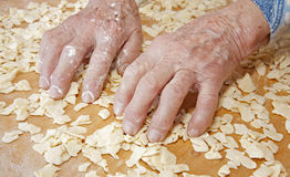 Hands of grandmother at cooking Stock Images