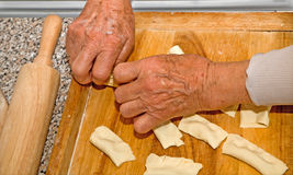 Hands of grandmother at cooking. Seniors Stock Photography