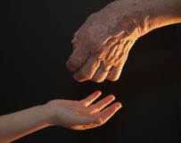 Hands of grandmother and grandchild Stock Photography