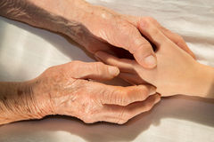 Hands of grandmother and grandchild Royalty Free Stock Image