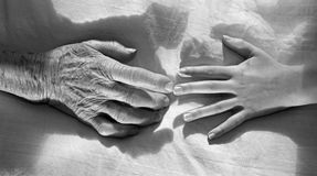 Hands of grandmother and grandchild Royalty Free Stock Photos