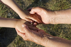 Hands of grandmother and grandchild Stock Photos