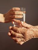 Hands of grandmother and grandchild - water Royalty Free Stock Image