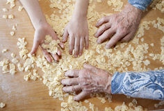 Hands of grandmother and grandchilds at cooking Royalty Free Stock Photography