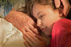 Hands of grandmother and granddaughter. In the morning Royalty Free Stock Image