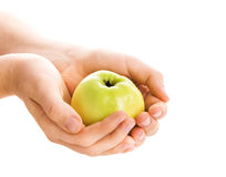 Hands with a green apple stock photo