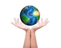 Hands with green earth over white background. Royalty Free Stock Images