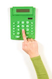 Hands in green jacket and green calculator Royalty Free Stock Photos