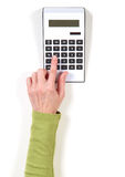 Hands in green jacket and white calculator Royalty Free Stock Image