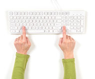 Hands in green jacket and white keyboard Stock Photos