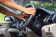 Hands grip the steering wheel accident. Hand of a man standing and holding the steering wheel in the car accident which fractured windshield Stock Photography