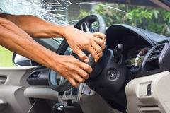 Hands grip the steering wheel accident. Hand of a man standing and holding the steering wheel in the car accident which fractured windshield Royalty Free Stock Photos
