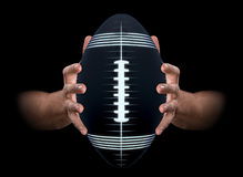 Hands Gripping Football Royalty Free Stock Image